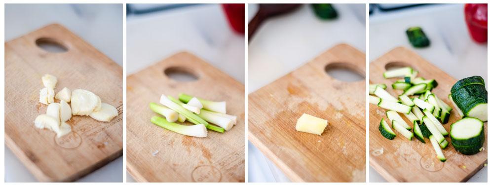 Pelamos y cortamos los ajos, los ajos tiernos, el jengibre y el calabacín.